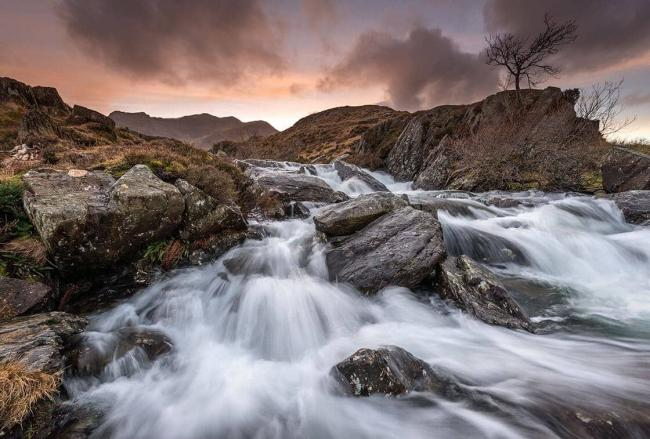 Sun rises over the waterfall at Llyn Idwal
