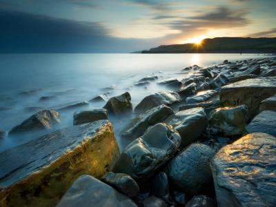 The sun setting over Kimmeridge Bay, Dorset